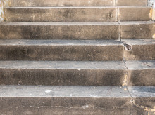 Dirty Cement Staircase With The Broken Step.