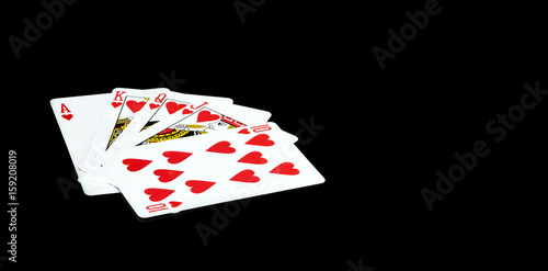 Playing cards on a black background. плакат