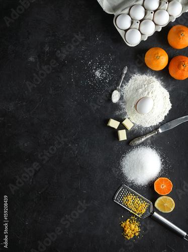 In de dag Bakkerij Ingredients for citrus cake on a dark stone background, Top view, Vertical