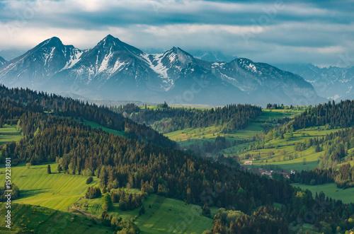 Aluminium Prints Mountains Beautiful spring panorama over Spisz highland to snowy Tatra mountains in the morning, Poland
