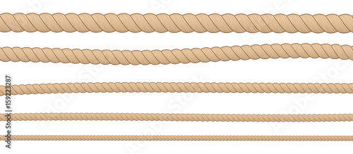 Photographie  Different thickness horizontal brown ropes isolated on white background