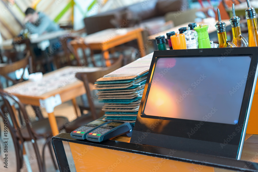 Fototapeta Point of sale, POS , table credit card terminal in modern restaurant