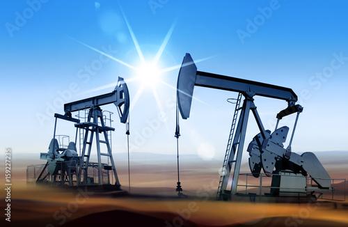Fototapeta oil pumps at sunset obraz