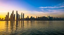 The Beauty Panorama Of Skyscrapers In Dubai From Promenade At Sunrise. UAE