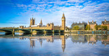 Fototapeta Londyn - Big Ben and Westminster parliament with blurry refletion in London, United Kingdom at sunny day.