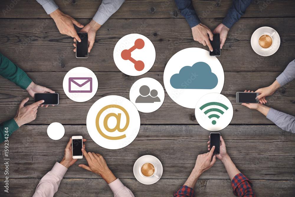 Fototapeta Business team working on smartphones. Social media internet network concept.