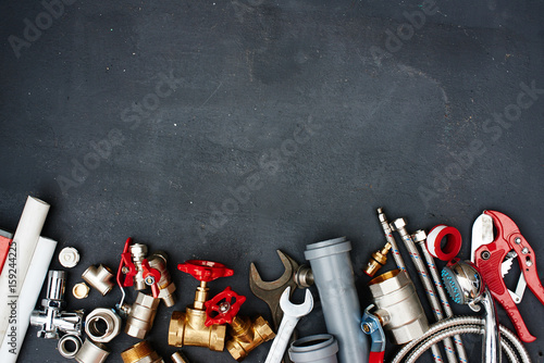 Top view of the plumbing equipment on a black background Fototapeta