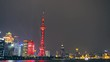 View of Shanghai Skyline at night. Oriental Pearl Tower and Huangpu River.