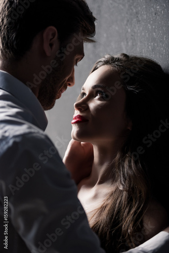 Fotografie, Obraz  young sensual couple able to kiss while standing near the wall