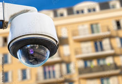 Fényképezés  security CCTV camera or surveillance system with modern luxury residence on blur