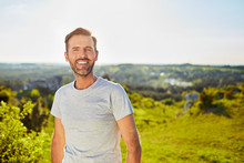 Portrait Of Smiling Man During Summer Walk Outdoors