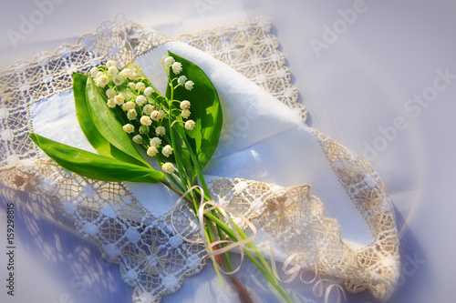 Wall Murals Lily of the valley Lily of the valley bouquet on the table.