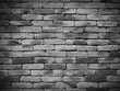 Vignetting Weathered texture of stained old black and white brick wall background, grungy rusty blocks of stone work