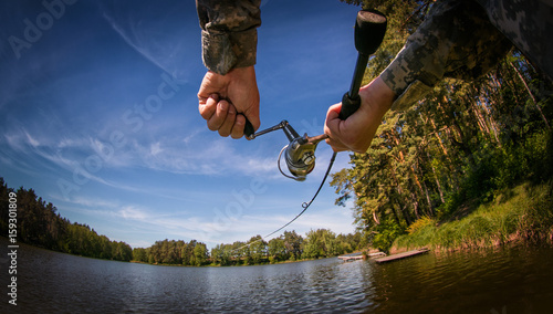 Printed kitchen splashbacks Fishing Fishing buckground. Fisherman with spinning on the lake.