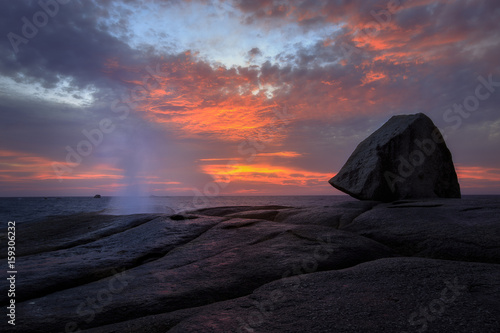 Fotografie, Tablou Bichino blowhole blowing at sunrise with red sky