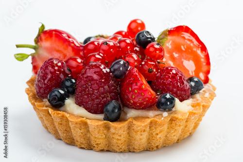 Obraz na plátně Fresh Fruit Tart with berries isolated on white background.