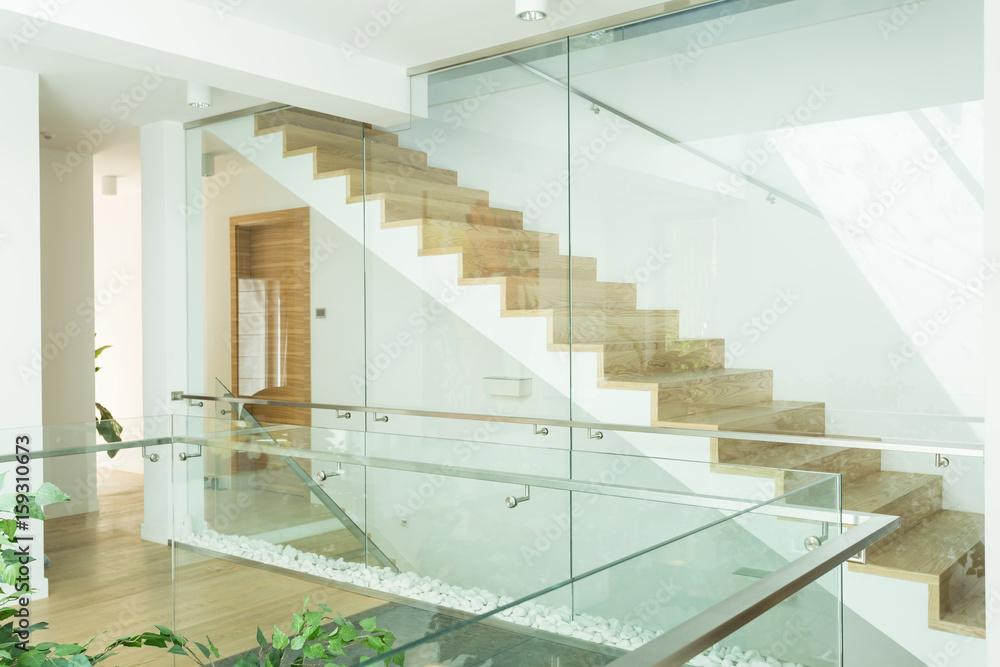 Fototapeta Bright corridor with minimalistic, wooden stairs