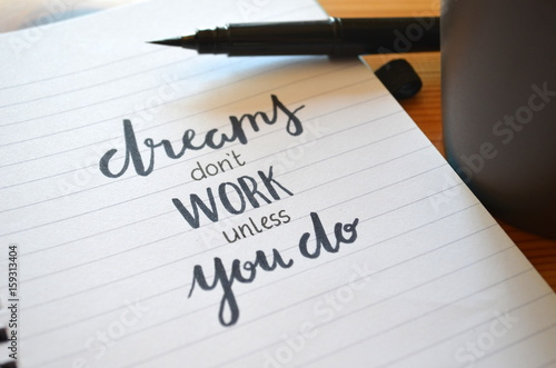Fotografie, Obraz  DREAMS DON'T WORK UNLESS YOU DO motivational quote written in notebook