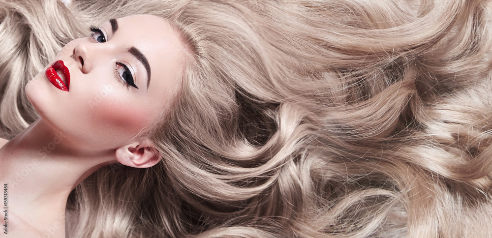 Fototapety, obrazy: Beautiful young well-groomed girl lies - close-up. Long light shiny healthy well-groomed long hair. Advertising of hair care, cosmetics, beauty. Makeup - red lips, black arrows, mascara.