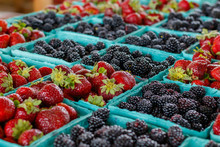 Strawberries And Blackberries At A Farmers Market