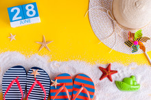 June 28th. Image Of June 28 Calendar On Yellow Sandy Background With Summer Beach, Traveler Outfit And Accessories. Summertime Concept