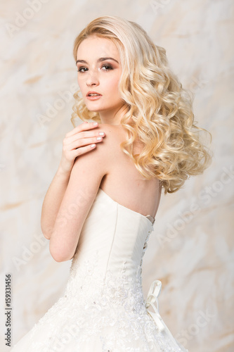 Fashionable Gown Beautiful Blonde Model Bride Hairstyle And Makeup