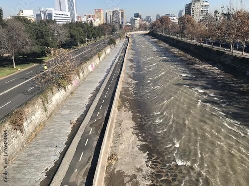 Foto op Plexiglas Fietsen People cycling along a river in Santiago, Chile