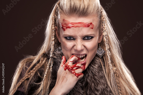 Portrait of viking woman in a traditional warrior clothes. Wallpaper Mural