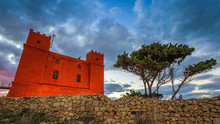 Il-Mellieha, Malta - St Agatha's Red Tower At Blue Hour With Tree And Beautiful Clouds And Sky