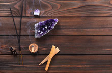 Composition Of Esoteric Objects Used For Healing, Meditation, Relaxation And Purifying. Amethyst Stones, Palo Santo Wood, Aromatic Sticks On Dark Background. .