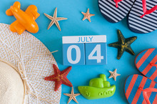July 4th. Image Of July 4 Calendar With Summer Beach Accessories And Traveler Outfit On Background. Summer Day, Vacation Concept