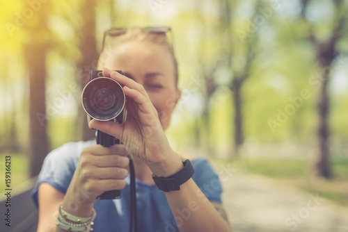 Photo  Summer. Young beautiful woman with vintage camera