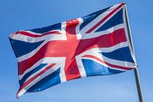 Union Flag Over A Clear Blue Sky