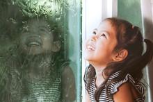 Happy Asian Little Girl Lookin...