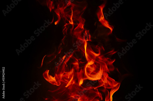 Poster Fire / Flame Fire Texture With Motion Blur Effect Over Black Background