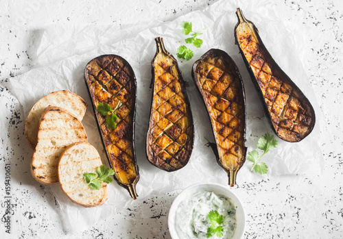 Grilled eggplant and sauce tzatziki on a light background, top view Canvas Print