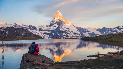 Fotografie, Obraz  Romantic couple at sunrise, from lake Stellisee, Swiss Alps , Matterhorn Peak, Z