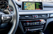 Modern car interior, steering wheel with media phone control buttons,navigation, screen multimedia system background, car interior details