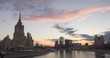 Timelapse cityscape of city at sunset with the movement of clouds and office buildings at background