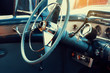 the interior of an vintage american car from the 50s