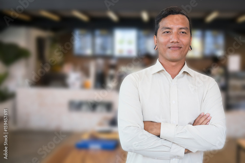 Fototapety, obrazy: Successful small business owner standing at his cafe coffee shop. young male entrepreneur smiling in front of his restaurant feeling confident