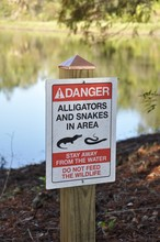 Danger Alligators And Snakes In The Area Stay Away From The Water Sign