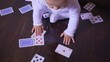 Newborn baby plays the playing cards in the room