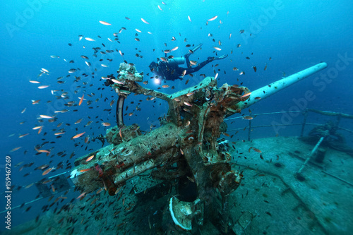 Wall Murals Shipwreck ship wreck in tropical sea ,cannon tower of a sunken ship with scuba diver,H.T.M.S. Prab Wreck Dive, Koh Ngam Noi Island , Chumphon Province Thailand