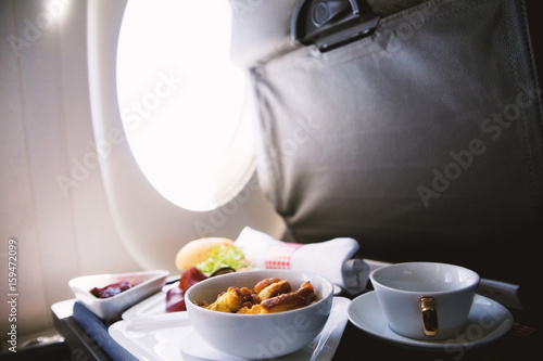 Photo Food served on board of business class airplane on the table