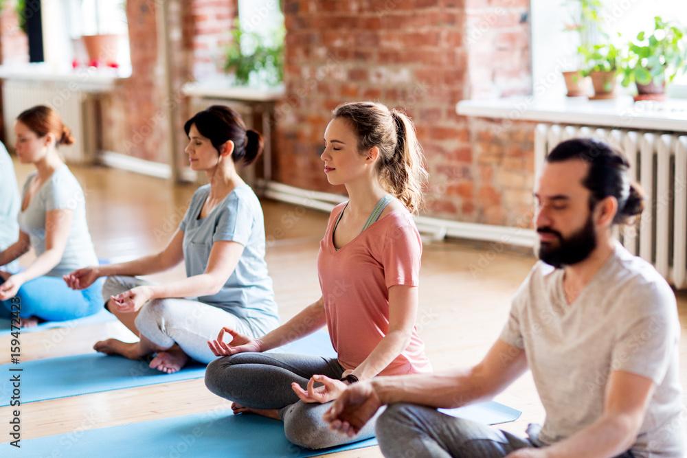 Fototapety, obrazy: group of people making yoga exercises at studio