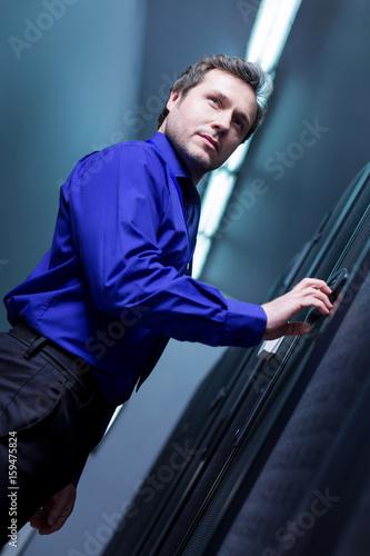 Fotografie, Obraz  Confident pleasant man entering the password