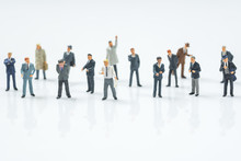 Crowd Of Business Miniature People On White Background