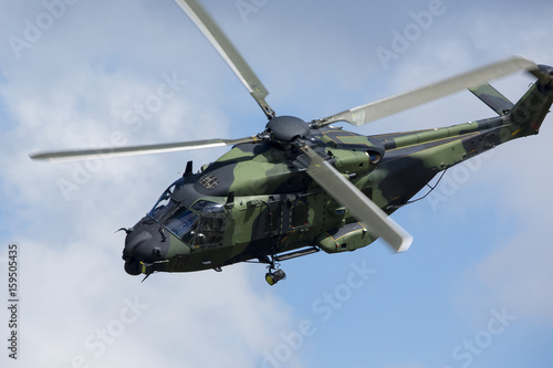 Tuinposter Helicopter Modern tactical helicopter flying close.