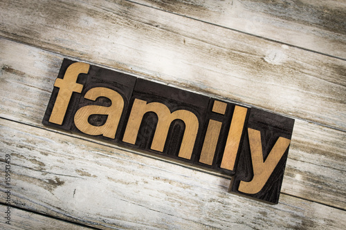 Photo  Family Letterpress Word on Wooden Background